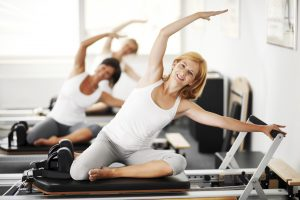 Three women exercising on a Pilates machine. [url=http://www.istockphoto.com/search/lightbox/9786766][img]http://dl.dropbox.com/u/40117171/sport.jpg[/img][/url]